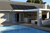 A neat arrangement of solar panels heats water for this pool.